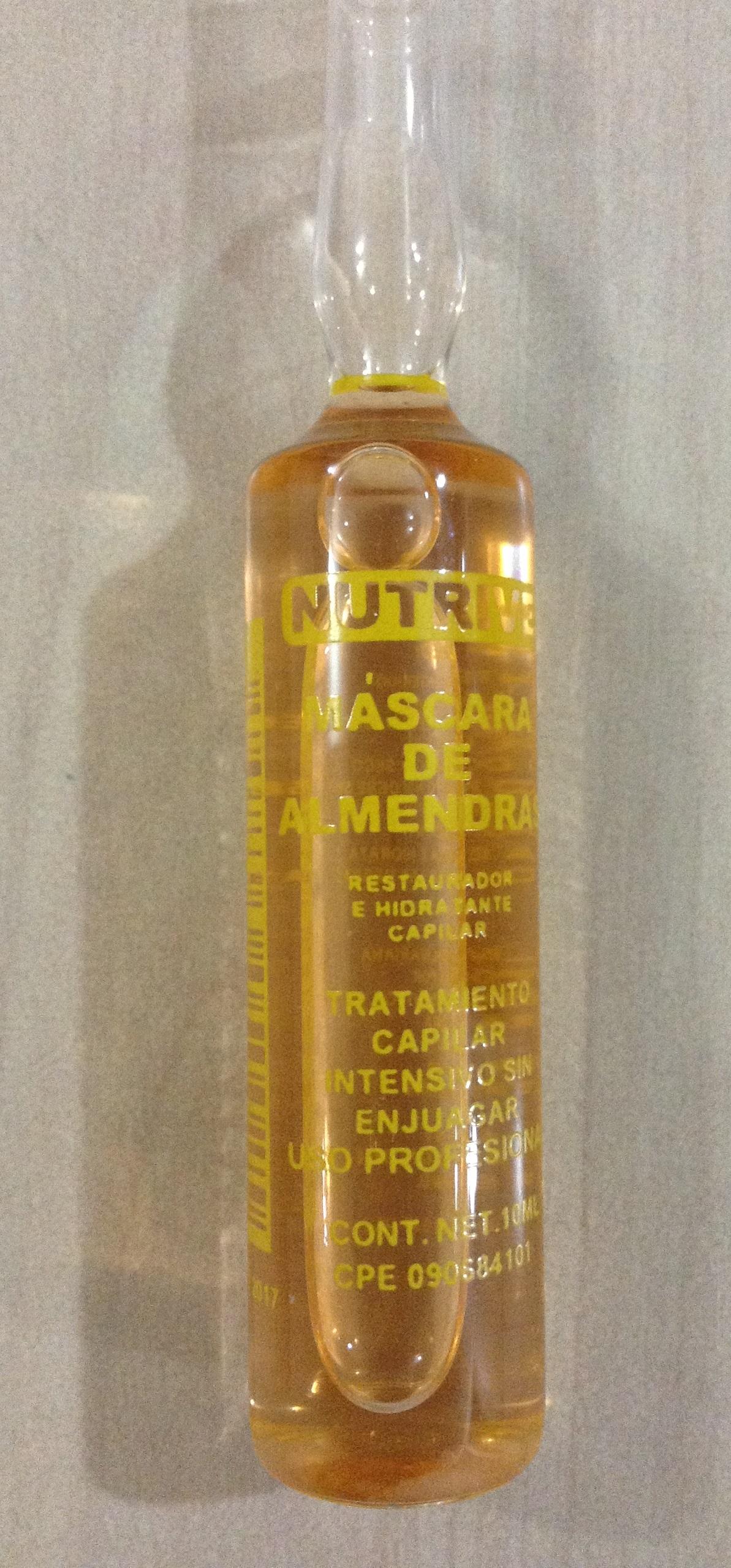 Las máscaras para los cabellos con las vitaminas en las ampollas con el aceite de bardana